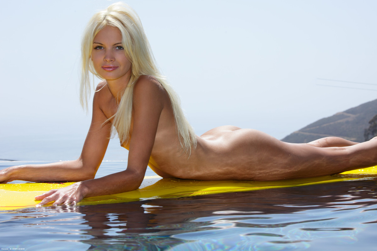 Blond nude surfer girl
