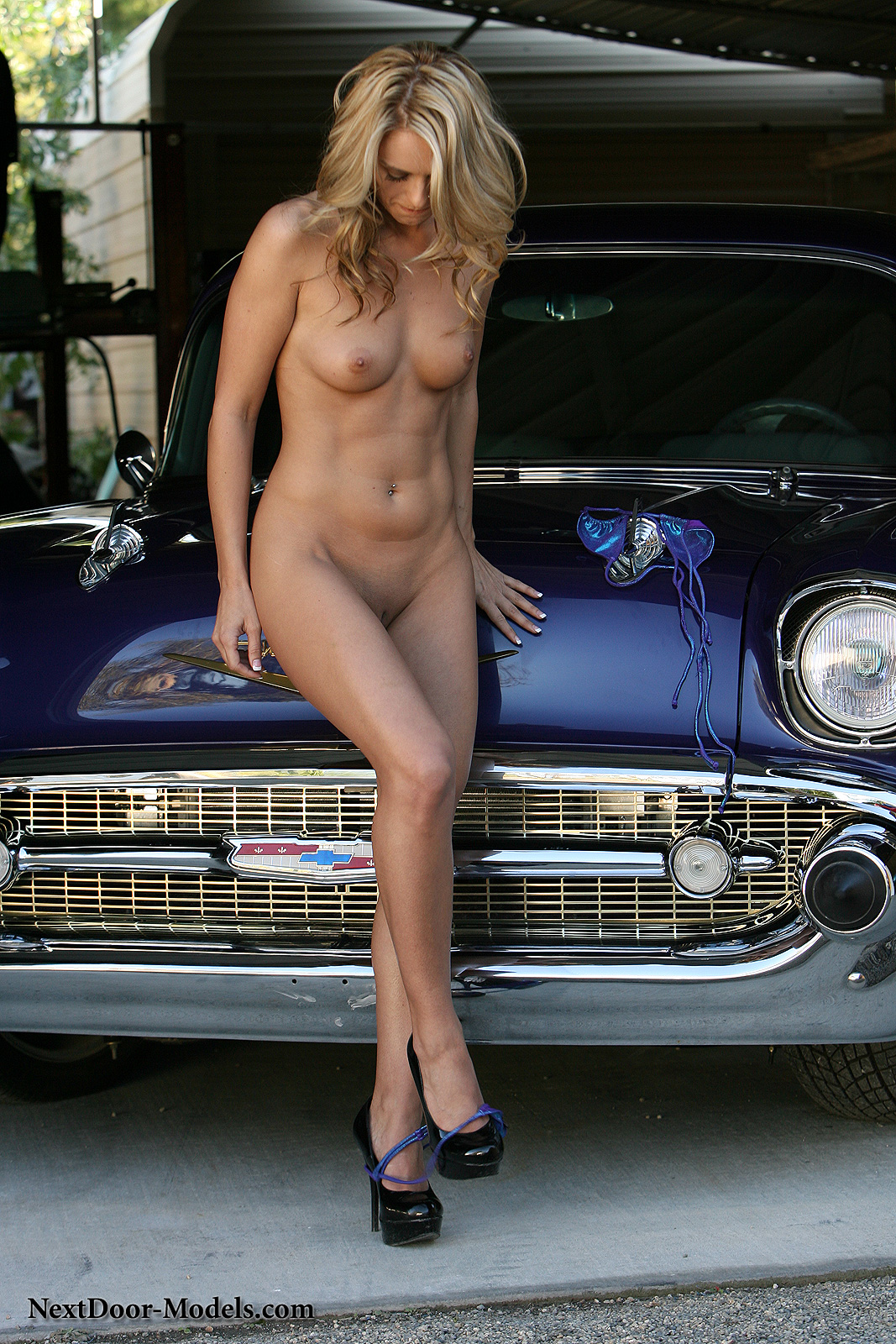 Hot blonde naked in the car