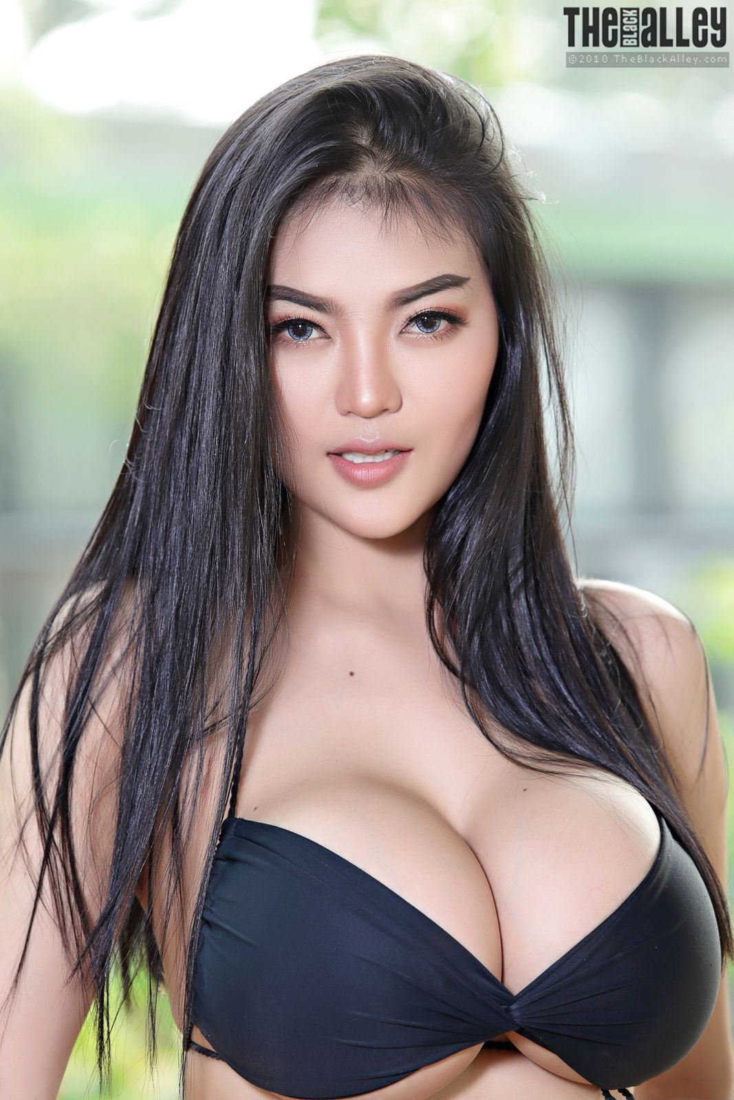 Sexy asian girl wearing black bra stock photo