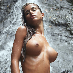 Waterfall under naked girls